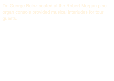 Dr. George Beloz seated at the Robert Morgan pipe organ console provided musical interludes for tour guests.