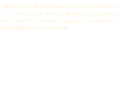 Mayor Jason Scott presents a City Proclamation to Church representative Dan Boudreaux and Jerry, a long-time FCC member, recognizing the church's importance in the community.